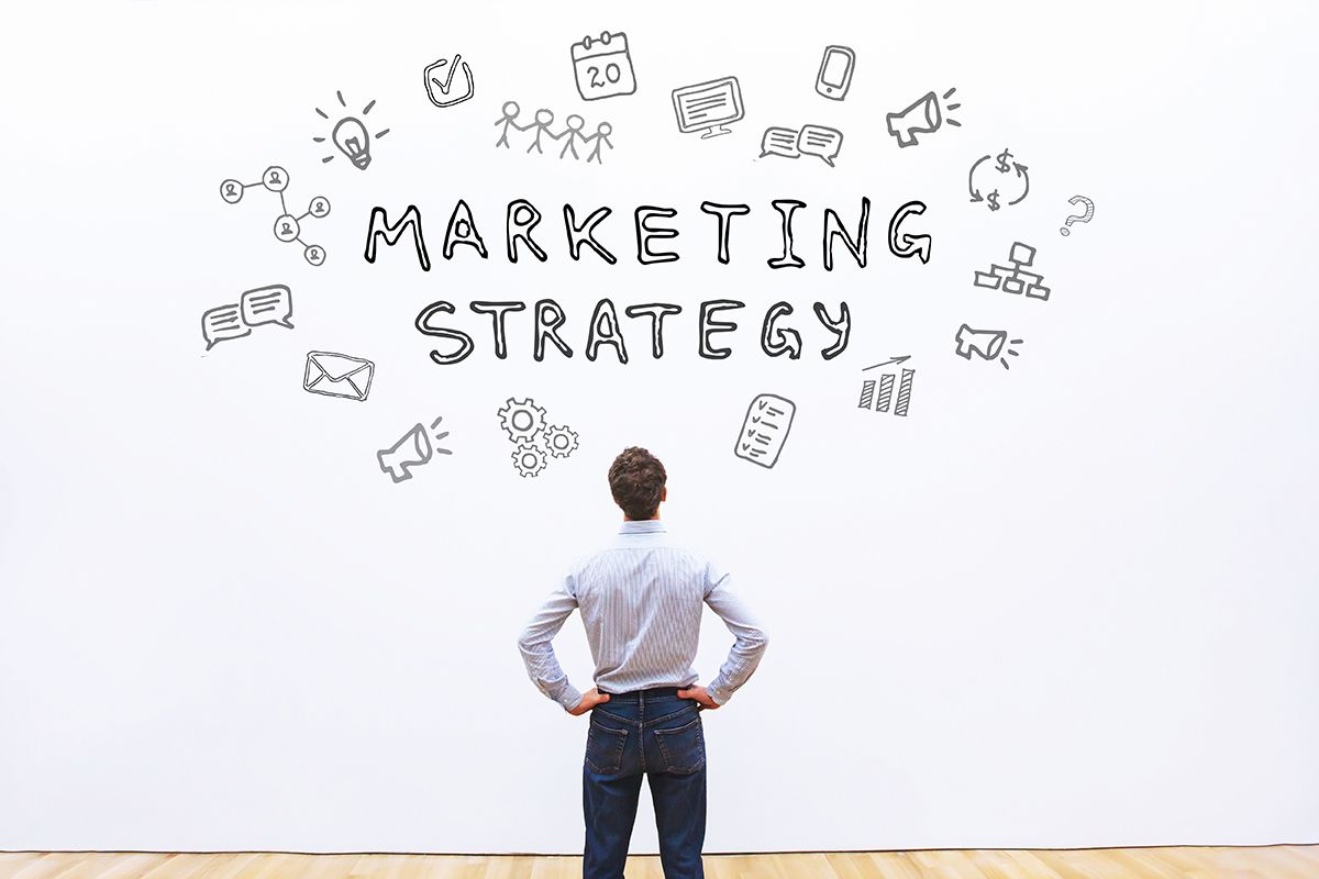 Example of creating a marketing strategy using a white board.